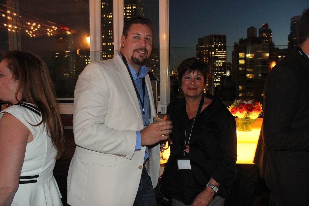 Guests with the NYC skyline | Corra's Exclusive pre-WWD Fashion Ecommerce Event, Strand Hotel in NYC